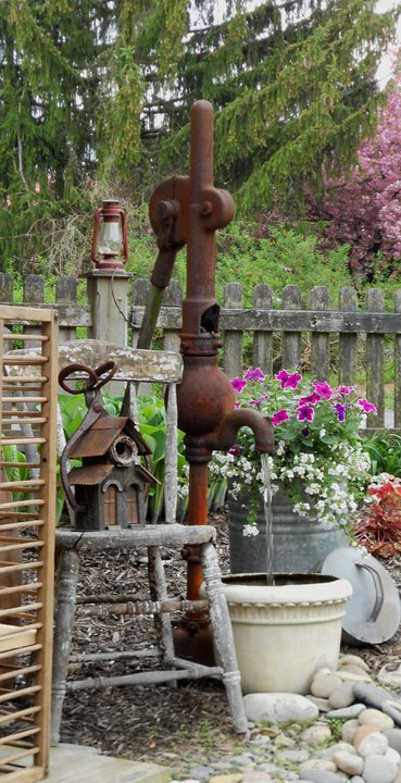The pump, ladder and found objects are all unified with wonderful rust!