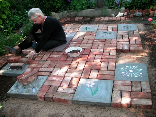 """Becky at work, figuring out her pattern and laying the bricks. """" - Becky's Big Patio Project Flea Market Gardening"""