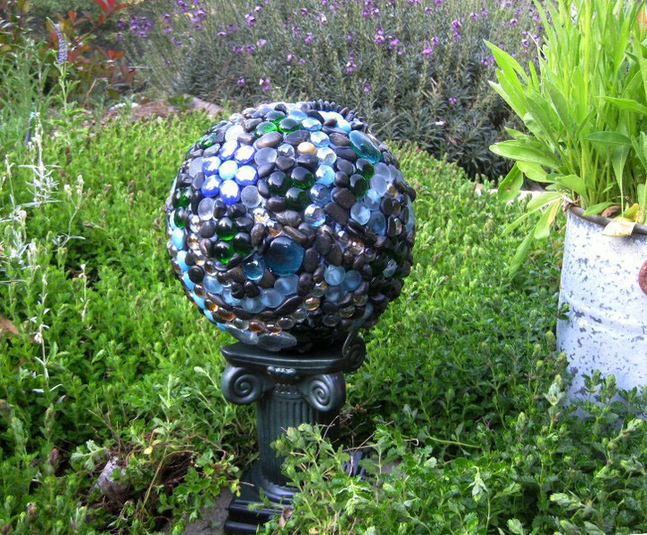 """The bowling ball, now """"garden art"""" on a stand in the garden. Later it fell off this plastic stand, so another place had to be found."""