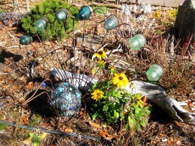 This metal peacock plant stand, found on trash day, became the new home for the bowling ball .