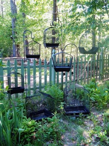 """Black birdcages in a grouping. """"The more, the merrier."""""""