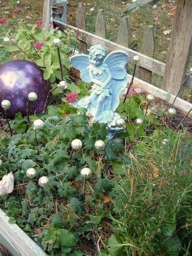 Di-Ellen's fairies and orbs decorate the pet memorial garden