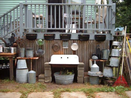 """Di-Ellen's play area, """"My little work area for potting up and tinkering. The sink looks so pretty filled with water and floating candles at night."""""""