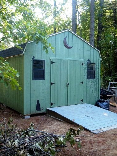 """""""Shed in front garden....needs tidying and flowers and whatnot.... Woodland Green from the Home Depot....yes, it's been loads of fun! I plan to finish it up in spring."""""""