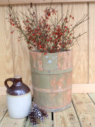 "Simple is sometimes better for a country Christmas look. Here, Cherrie Carine says, "" My old bucket looking pretty...I just love it!"""