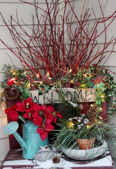 Chris Hiller also used red branches and mini lights in a porch decoration. Don't you love the red and Robin's egg blue color combination for the Holiday?
