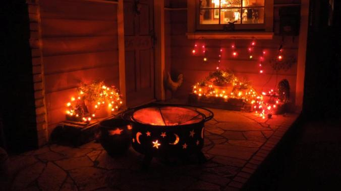 Marla Bergman Rhoades uses colored lights, a pine cone decorated firepit and lots more for a front porch welcome!