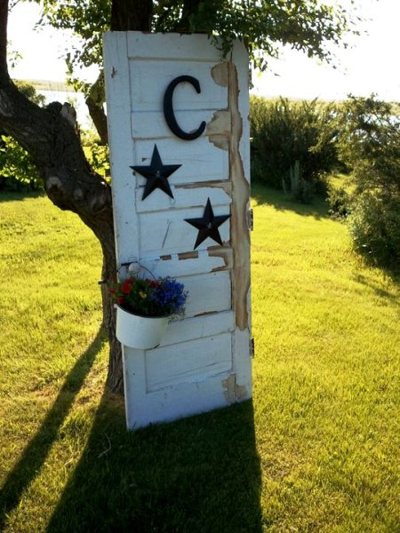 "Old door decorated with a ""C"" for Clark"