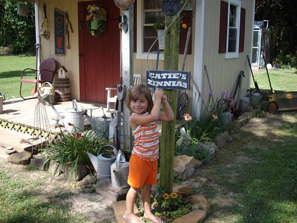 Granddaughter, Catie loves my potting shed
