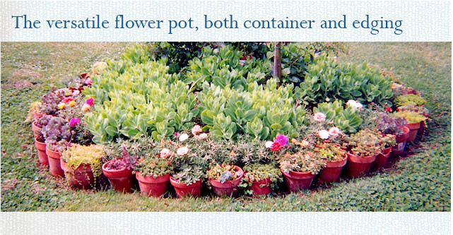 Flower pot edged raised bed by Stephie McCarthy
