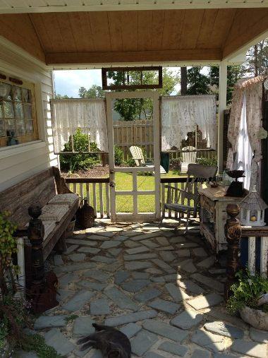 Kim Trudo's porch with shutters and old windows