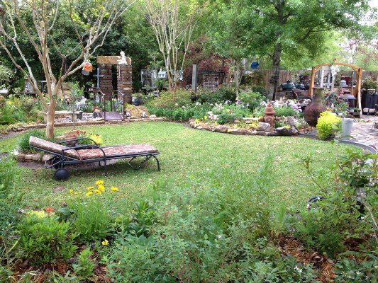 Kathy's garden has a 'meadow' style with a lawn surrounded by natural curves and flower beds