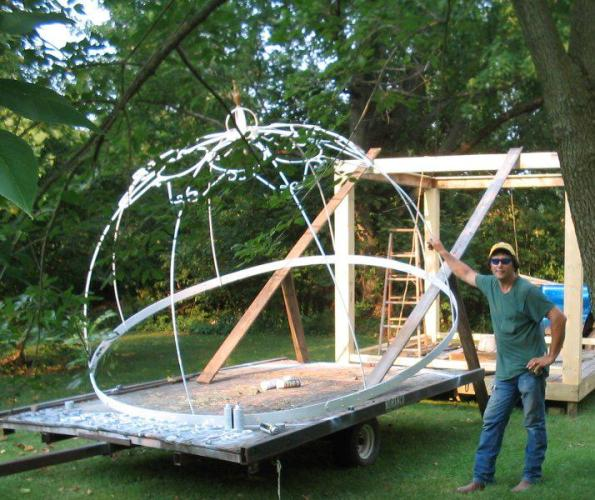 Randy made the iron top for our gazebo. This is down by our bonfire site. It has proven to be a nice addition. The top looks like a giant crown.
