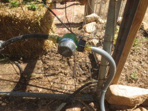 Timer wired to the fence for easy reach.