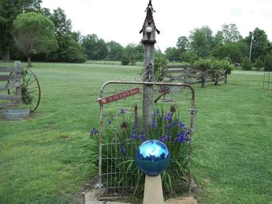 Debbie McMurry's old gate and blue gazing ball...and, a nice view of her 'park.'