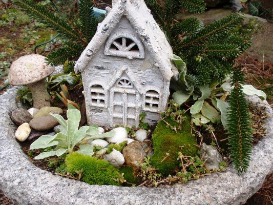 Cherrie Carine's teeny fairy house made with twig trim and white-washed