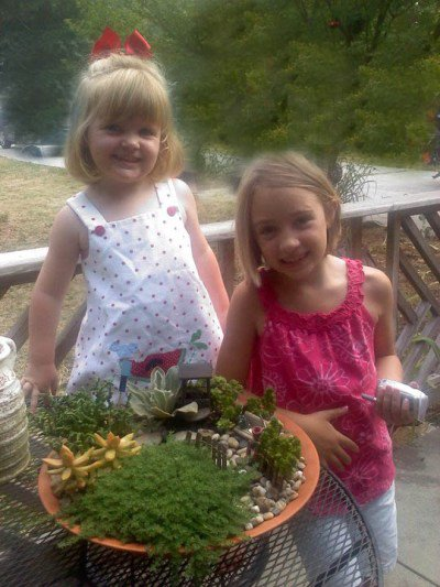 "Kay Bassett's little ""fairies"" enjoy their garden."