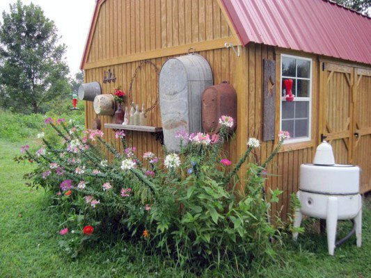 A  shed of any age, hung with old galvanized tubs and a vintage washer in Tony Johnson's garden.