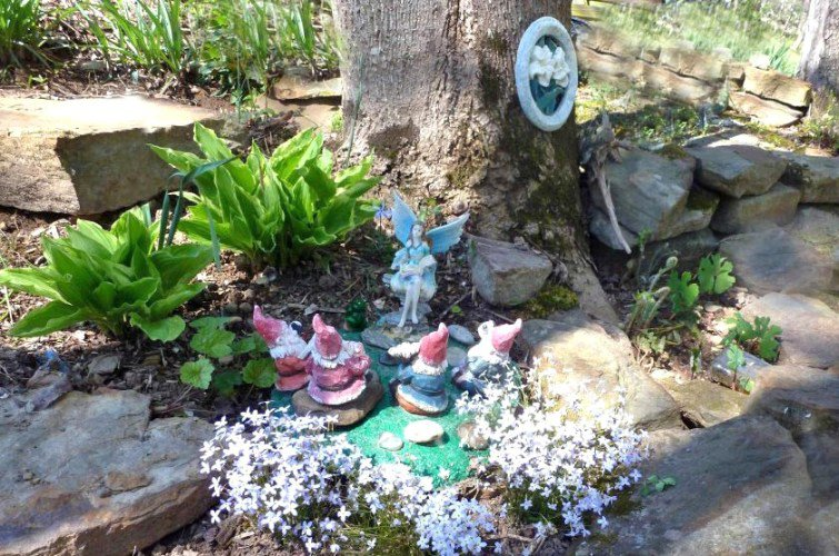 """Cheryl York's fairy tells a group of gnomes, """"what for and how to..."""""""