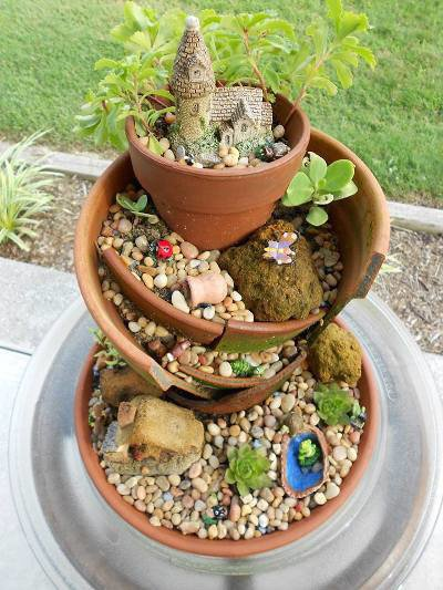Mary Everett stacked the pieces of a broken pot and saved her pot!