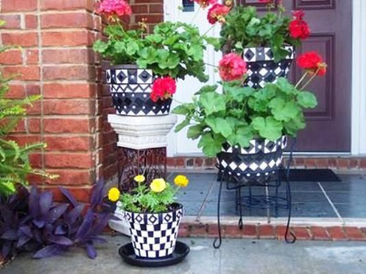 Paulette Clements and her checkerboard pots make a classy porch greeter