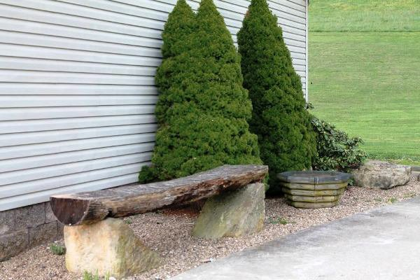 """Lisa Collier says, """"My favorite rocks, the base for a bench,  were the cornerstone to the fireplace to the old mansion that once stood where our house now stands."""""""