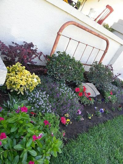 A bed frame is appropriate for a flower bed
