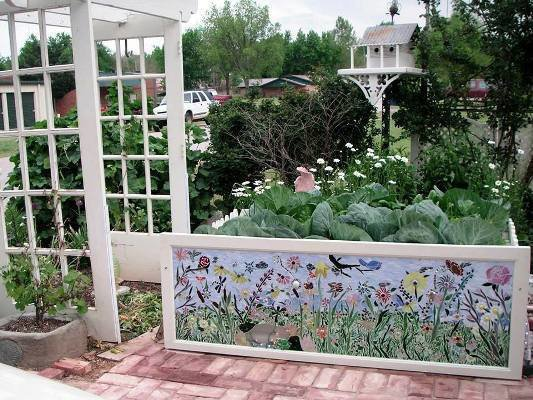Becky created an intricate tile panel attached to her raised bed