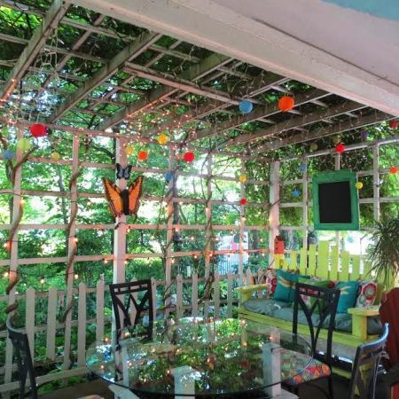 A delightful place to sit surrounded by charming lattice and lights