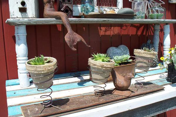 Sue Gerdes works on her spring pots at her potting table