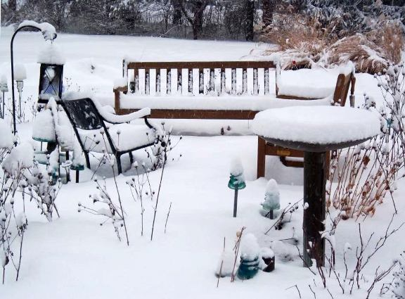 Aunt Pritty's patio set waits through the icy Winter for its next occupants.