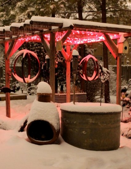 Barb Brashier effectively uses colored lights to jazz up her snowy garden dining arbor