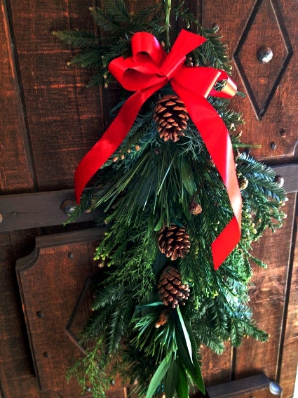 Beautiful door ornament by Hilda Evans, with native greens