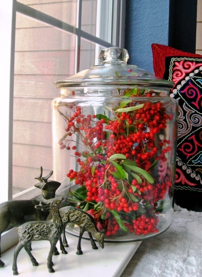 My windowsill decorated with winter berries under glass