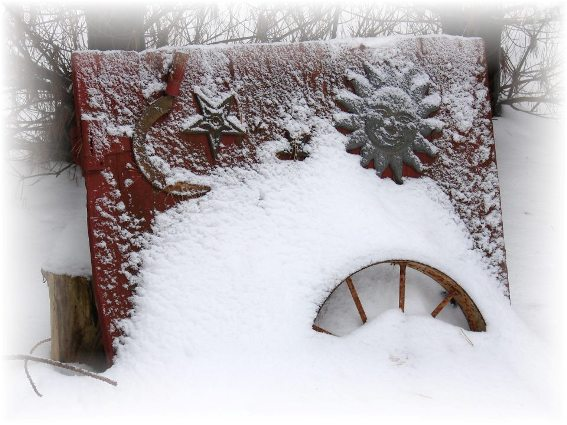 Jeanne Sammons's barnwood door collects snowy designs as flakes fall