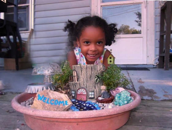 "Misti Manns says, ""My grand daughter, Destinee, with our first Fairy Garden"