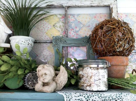 Angels, buttons and soft pastels grace a shelf in Ann Elias's garden