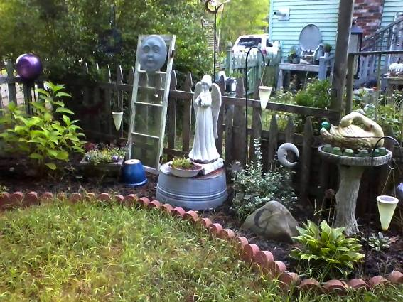 Di-Ellen Davenport's flower bed is watched over by this serene angel