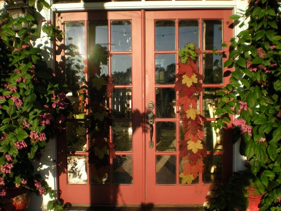 Billie's French doors painted a rosy terracotta color