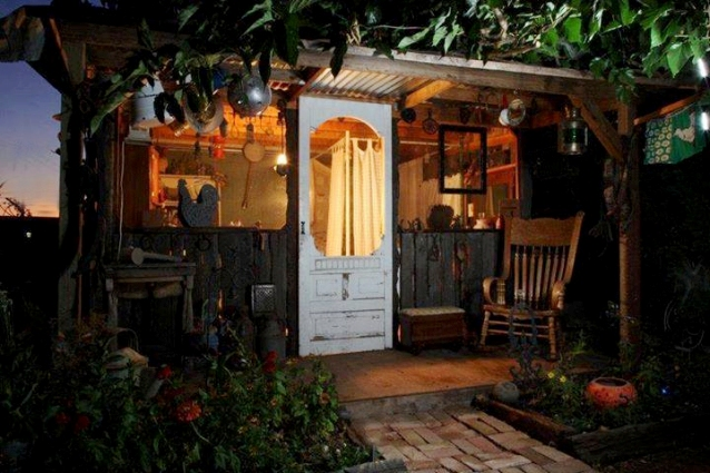 "Lisa Royal says, ""My husband built this shanty for me in my garden. It is filled with Flea Market finds and treasures i have collected over the years. Family and friends love to visit and spend the night in this little treasure."""