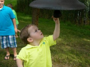 Barb's grandson, Landon, getting a close look at the bell