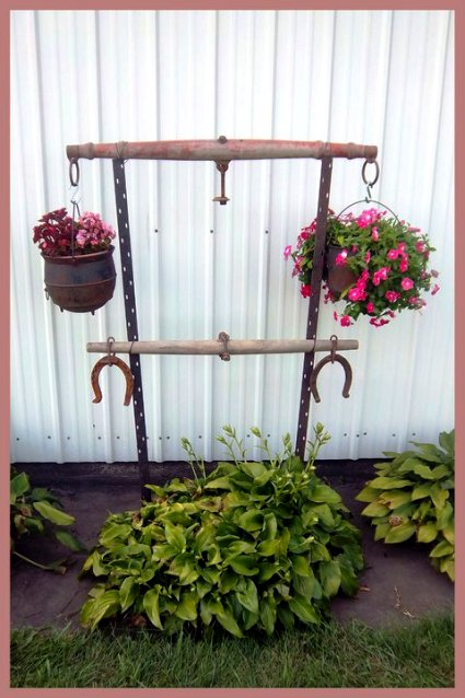 Nancy K Meyer's singletree plant hanger is displayed as well as displaying her flowerpots