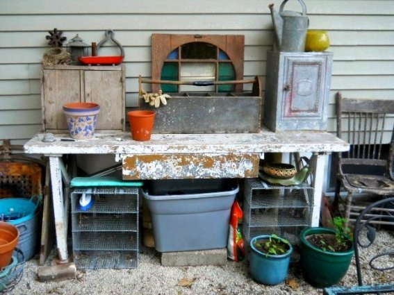 Laurie Wanat's rustic and practical potting table. You can make a mess here and play!