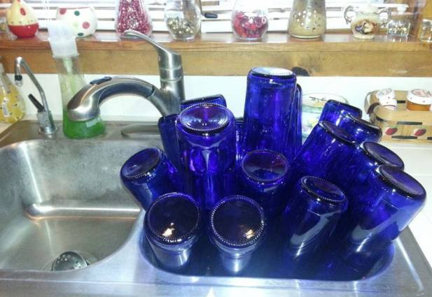 Nancy Carter's sink full of bottles