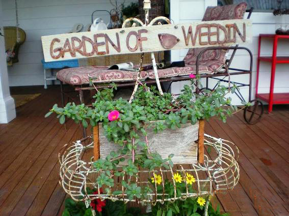Billie Hayman's 'found' sign 'Garden of Weedin'