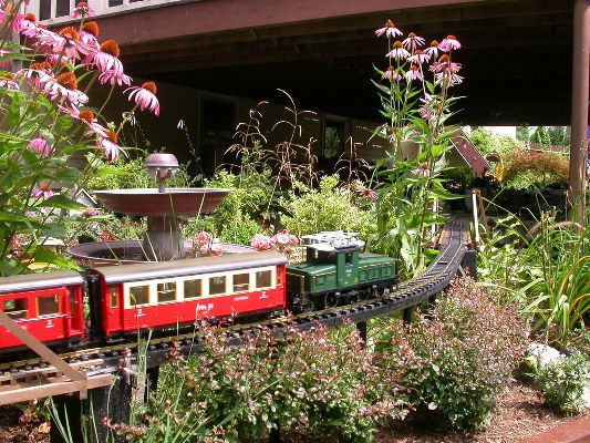 Why not bring a discarded train set into your garden scene?!