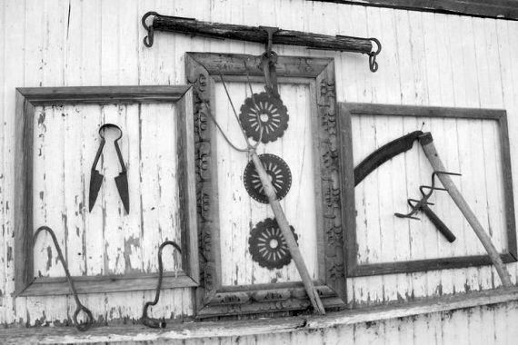 Sue Gerdes used three old picture frames to  display old tools.  Art!
