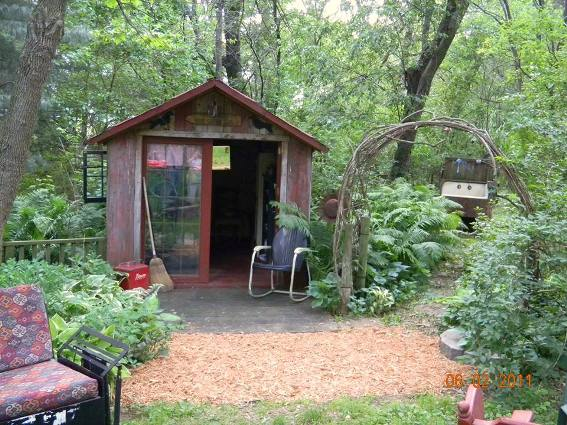Bobbi Doll's rustic retreat is secluded in the trees