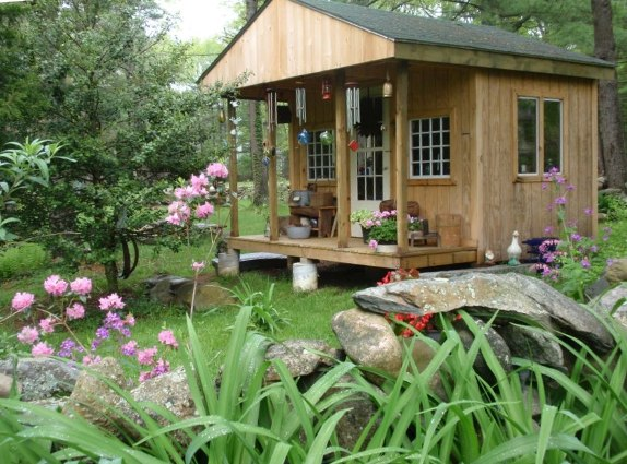 """Cherrie Carine exclaims,""""It is functional! It was used by my children when they were small. It now serves as a shed for my small garden tools.""""  We think it's also charming."""