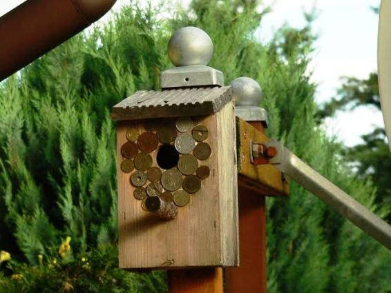 Coin covered birdhouse